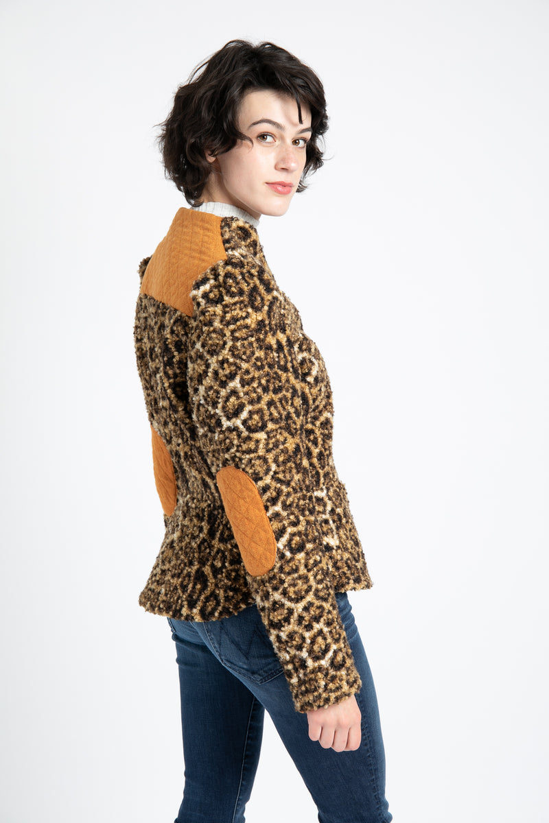 Model is wearing AlekSandraD leopard-print wool teddy jacket with quilted details.
