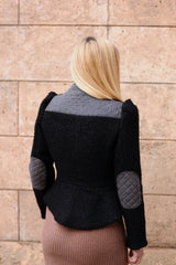 Model is wearing AlekSandraD black short teddy jacket with quilted details.