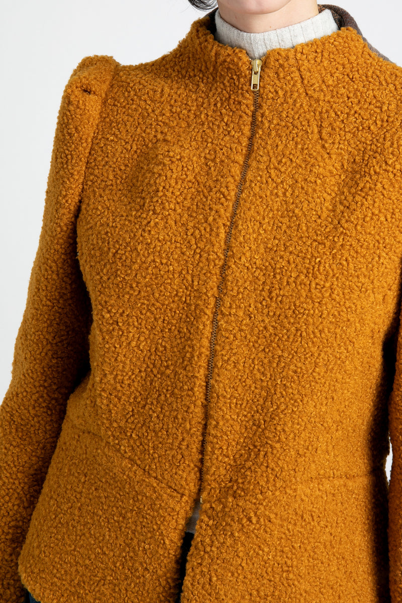 A front close up of AlekSandraD orange teddy wool jacket.