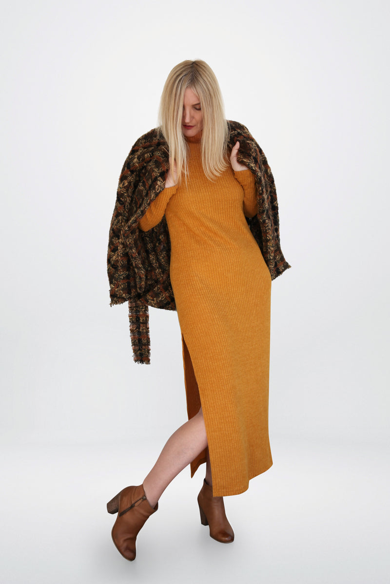 Model is wearing  mustard  sweater  dress and a brown cashmere  coat designed by AlekSandraD.