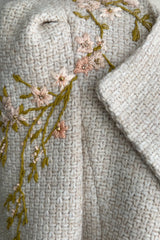 A close up look at embroidered detail on AlekSandraD wool jacket.
