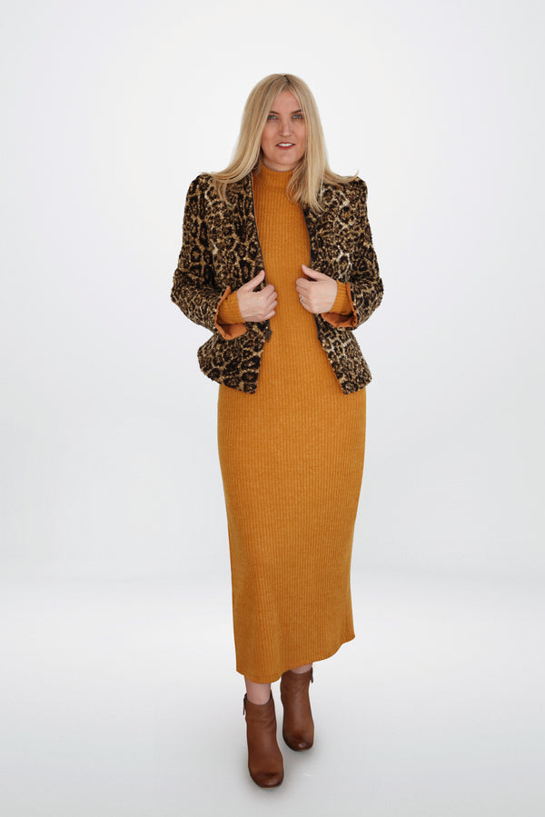 Model is wearing  mustard  sweater  dress and a leopard print teddy jacket designed by AlekSandraD.