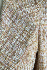 A close up of AlekSandraD blush gold-tweed coat.