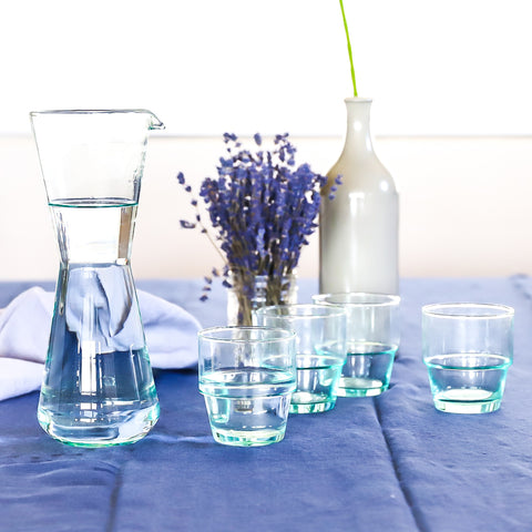 Recycled glass carafe and stacking tumblers. Ecofriendly and efficient design.