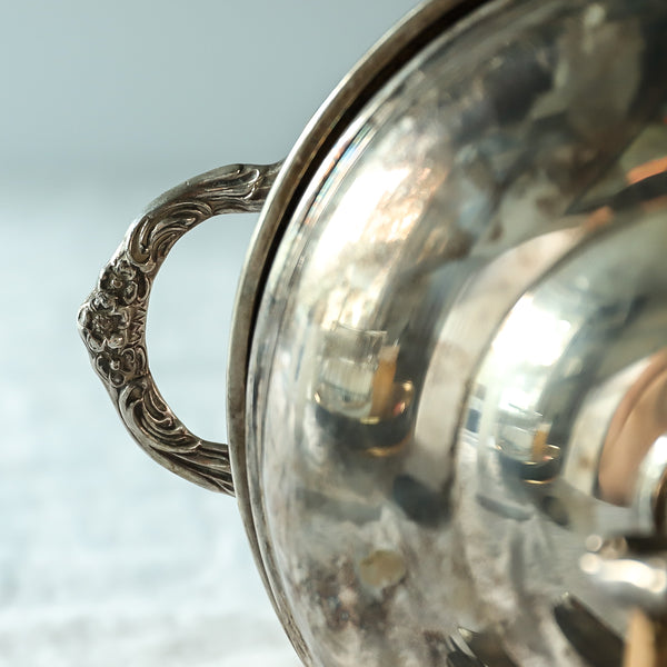 Silver ice bucket with ornate handles