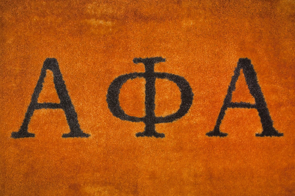 carpet letters. alpha phi gold carpet with black letters o