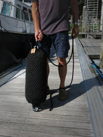Man holding a Black Nautiqo Rope Fender size XL