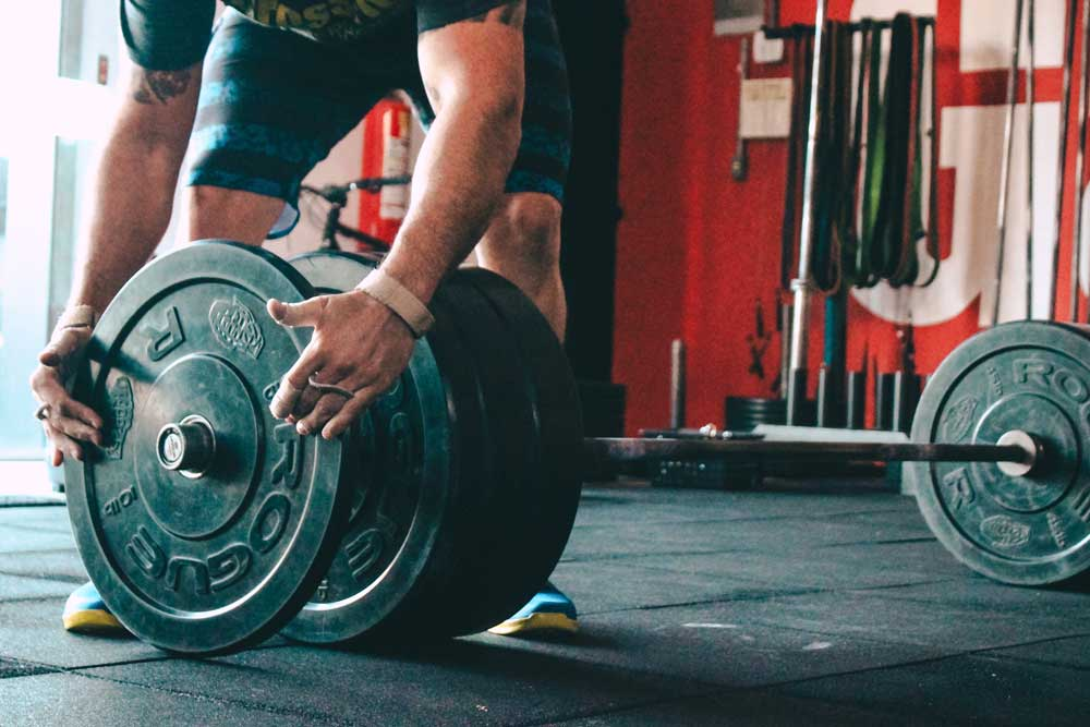 strength training for marathon runners common misconceptions - weights