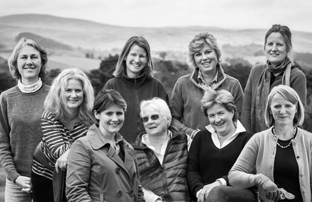 Group photograph of the nine women who make up the Tea Gardens of Scotland