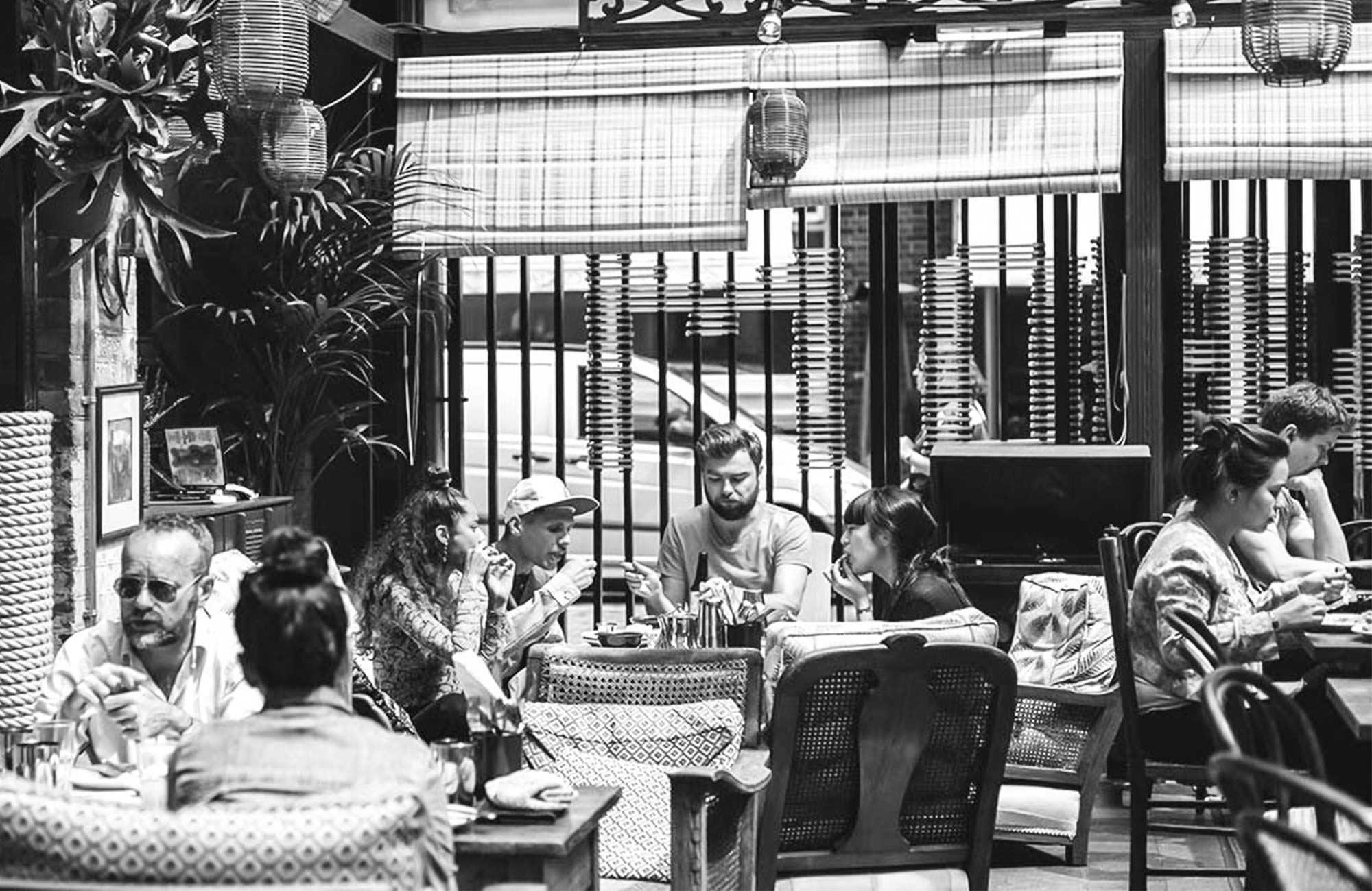People outdoor dining at Dishoom Shoreditch on the verandah