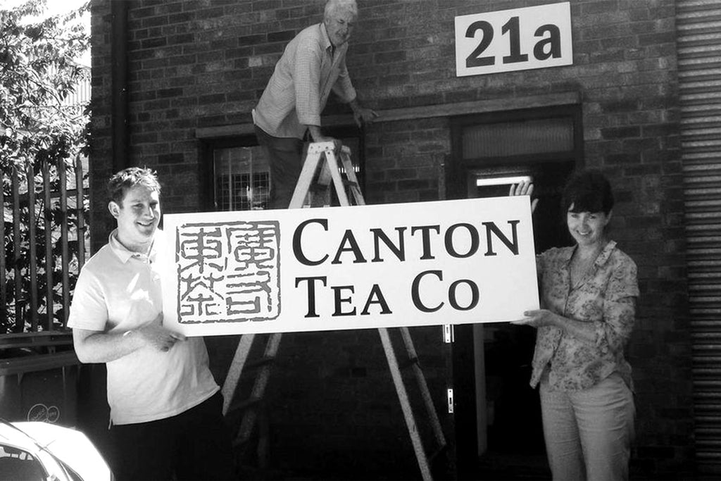 Co-founders Jen and Edgar putting up original Canton Tea Company sign