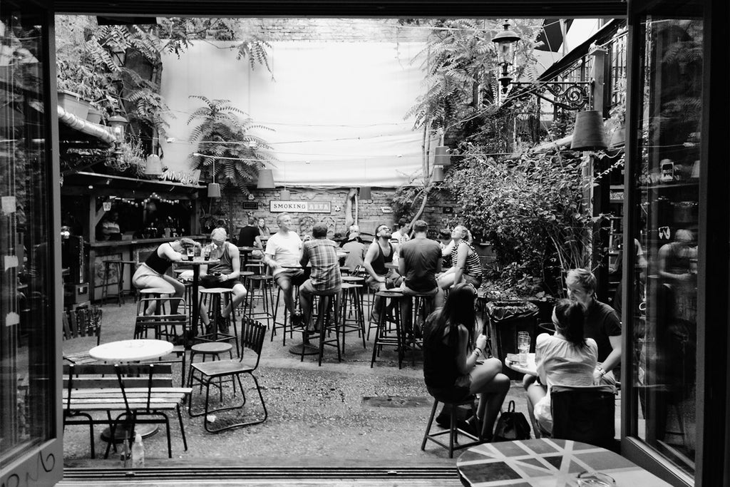 Friends eating and drinking in outdoor bar