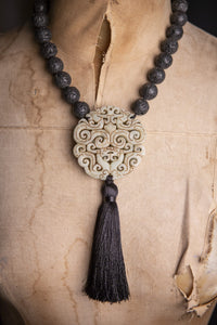 Jade pendant and lava stone tassel necklace