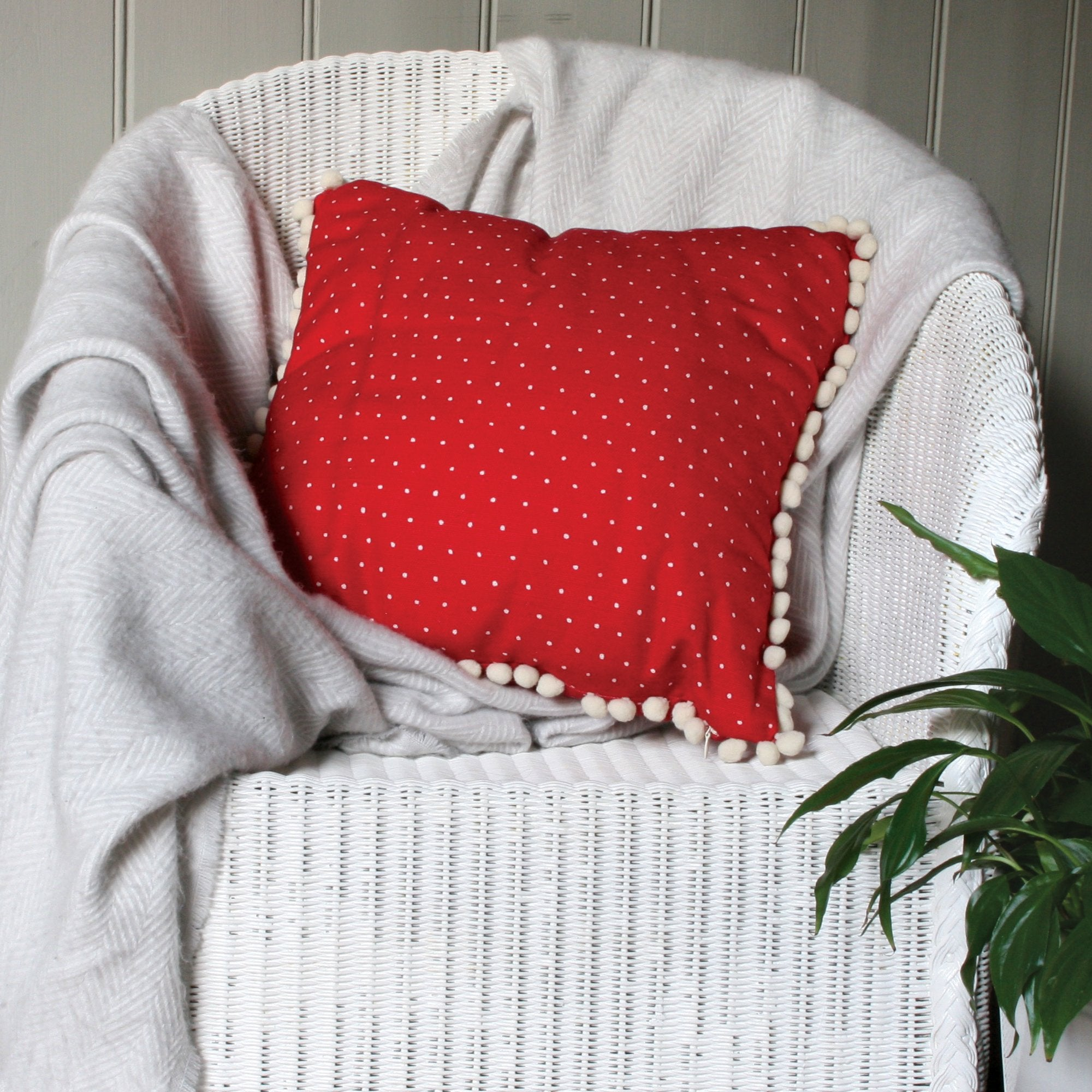 Red Cushion with White Polka dots and Cream Pom Pom Trim