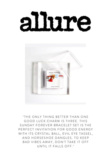 """ALLURE  """"The only thing better than one good luck charm is three. This Sunday Forever bracelet set is the perfect invitation for good energy with its crystal ball, evil eye tassel, and horseshoe dangles. To keep bad vibes away, don't take it off until it falls off."""""""
