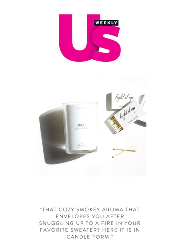 """USWEEKLY """"That cozy smokey aroma that envelopes you after snuggling up to a fire in your favorite sweater? Here it is in candle form."""""""