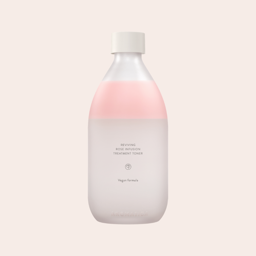 Light pink natural Aromatica Reviving Rose Toner in a glass bottle