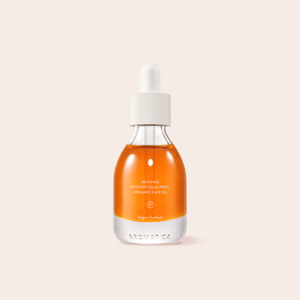 Bright orange Aromatica Reviving Rosehip Cold Press Organic Face Oil in glass bottle packaging