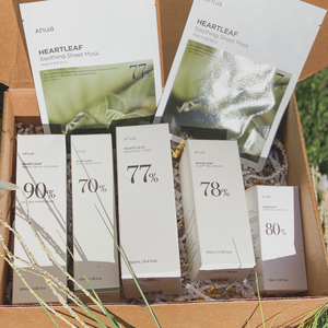 ANUA heartleaf skin care products in kraft box outside.