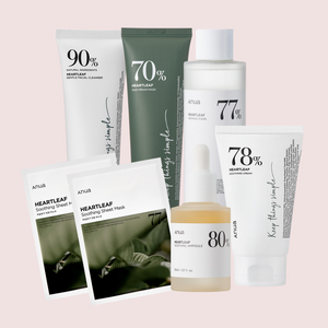 ANUA heartleaf skincare set including cleanser, cream mask, toner, ampoule, cream, and two sheet masks