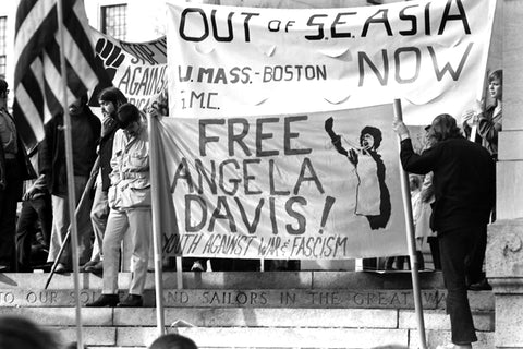 People protesting to free Angela Davis at anti-Vietnam war protests 1970