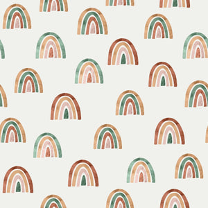 Illustration of Image of Family Fabrics rainbow cotton jersey knit on a roll. Fabric has off white background and multiple multicoloured rainbows painted in a watercolour style.