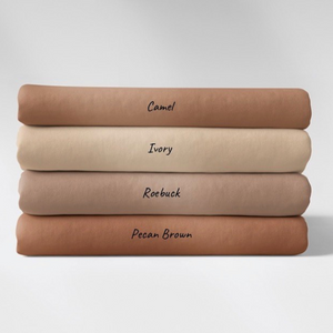 A stack of 4 Family Fabrics solid cotton jersey knits in shades of brown and beige. The shades are camel, ivory, roebuck and pecan brown