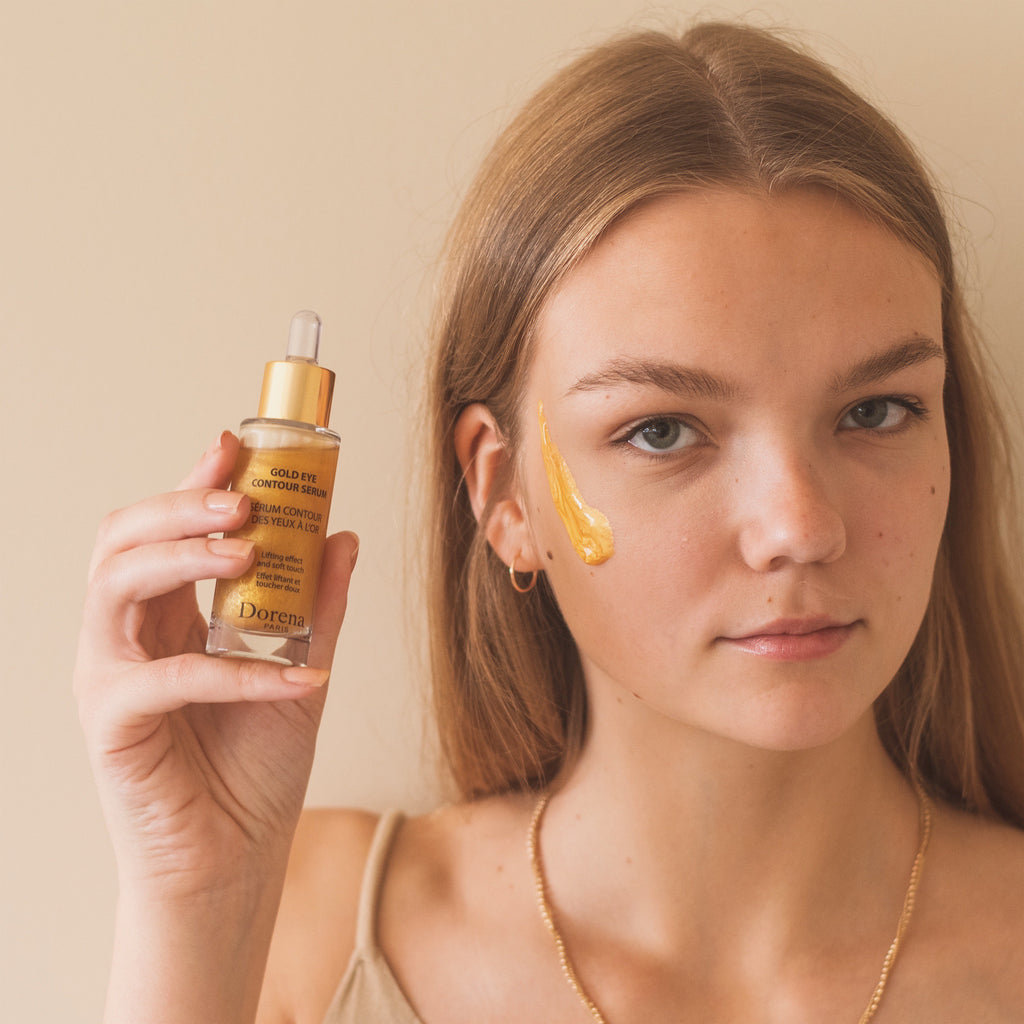 Gold eye contour serum with gold peel off mask on young women models face made in France from Dorena Cosmetics