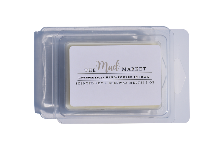 Hand-poured scented wax melts poured into a clamshell mold.