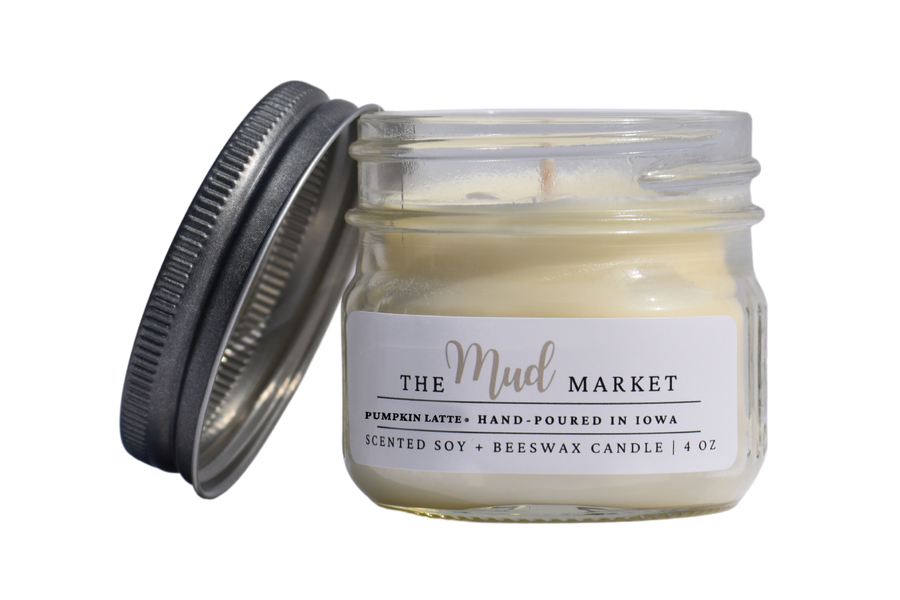 Hand-poured autumn scented candle, adorned with a pewter style rustic lid and minimalist label