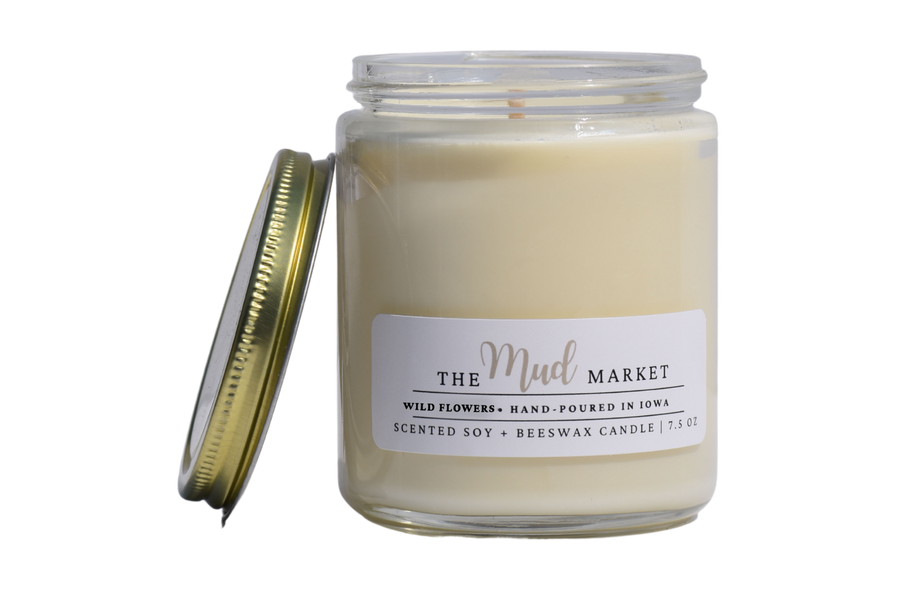 Hand-poured scented candle adorned with a gold lid.