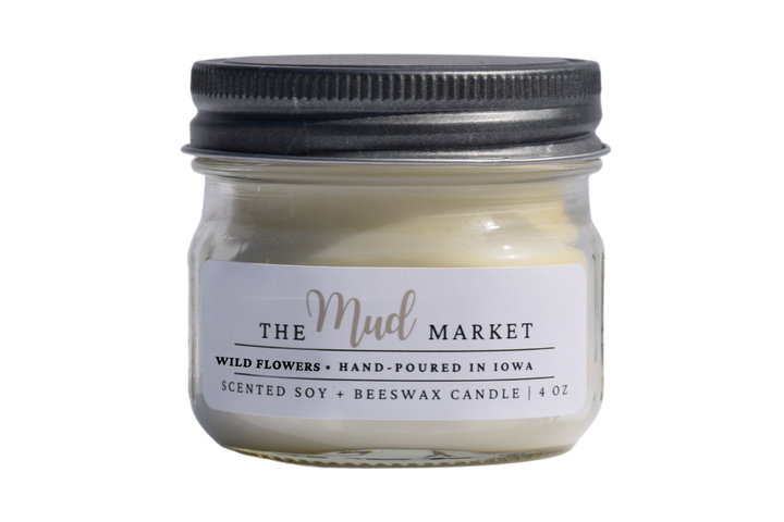 Hand-poured scented candle adorned with a rustic pewter lid poured into a mini mason jar.