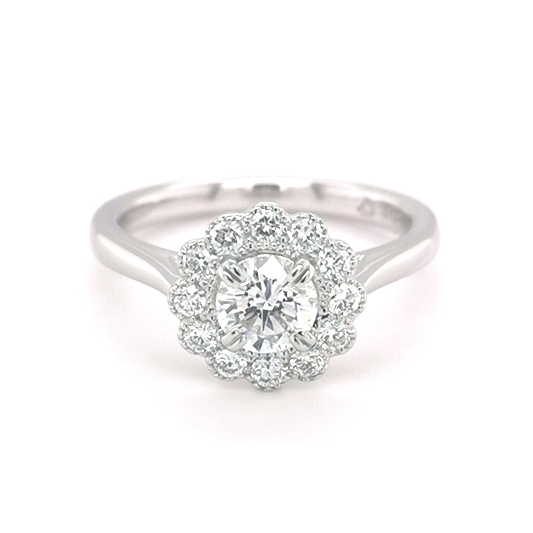 Platinum Round Brilliant Cut 0.50ct Diamond Flower Halo Ring