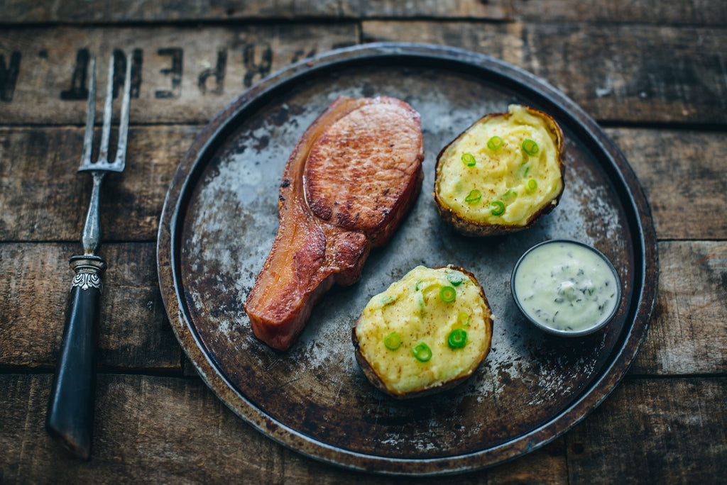 Bacon Chops with Baked Potato Champ and Parsley Sauce