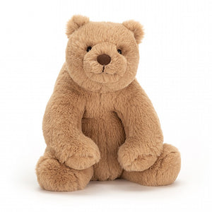 A soft, light brown, tubby toy bear sitting upright.
