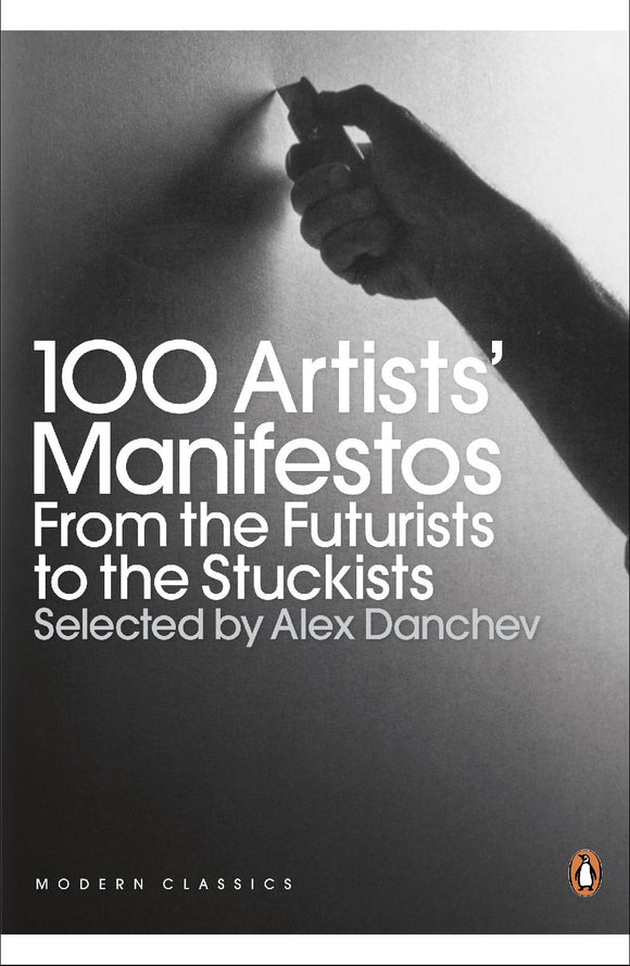 The cover for the book '100 Artists's Manifestos From the Futurists to the Stuckists'. It shows the title in white text with 'Selected by Alex Danchev' underneath in a light grey. This is all aligned to the left in the centre of the cover. The image behind this is a grey scale photo. It shows the silhouetted hand of an uknown person holding a blade. about to press it into a canvas. It has a thin white border at the top and bottom of the cover.