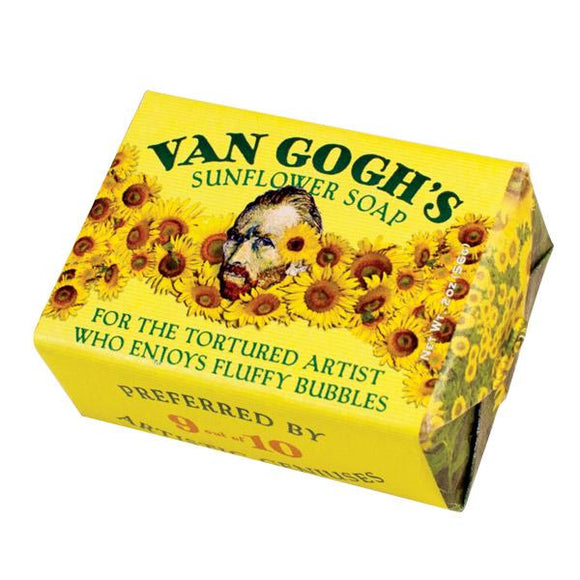 A block wrapped in yellow paper. On the top is a portrait of van Gogh with sunflowers around him and spreading off to the sides. The soap name is across the top in dark green letters and underneath is 'For the tortured artist who enjoys fluffy bubbles'. There are sunflowers on the sides.