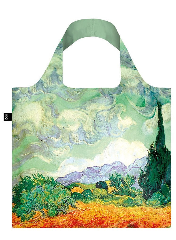 A square bag covered in a painting of a golden wheat field with a tall dark cypress tree to the right. The sky above is swirls of pale green and blue. The lining of the handle is a matching sage green.