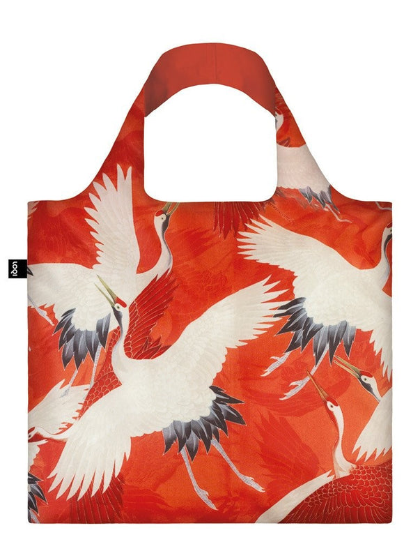 A square bag covered in an illustration of white crane birds against a red background. The lining of the handle is a matching red.