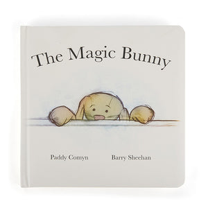 A white cover with a simple illustration of a brown toy rabbit peaking over the edge of a table. The title is across the top in black.