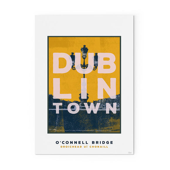 A print of an old three sconce lamp on the wall of a bridge, with buildings in the background. The main image is dark grey, with a yellow sky. 'Dublin Town' is printed in large white capitals over top, taking up most of the image. The print has a white border with the title in the bottom.