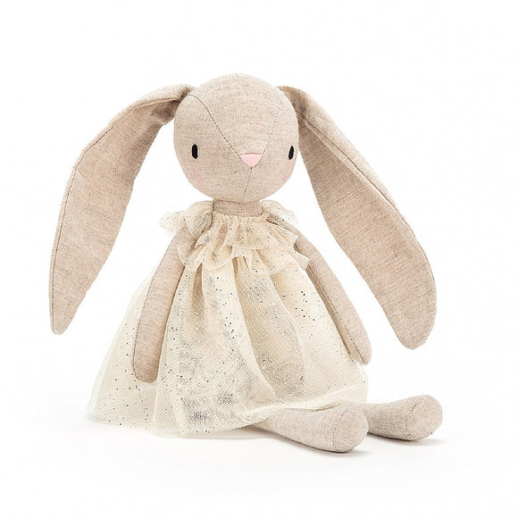 A beige toy bunny with long ears and a sparkly cream dress. It has long, narrow limbs and a pink nose.