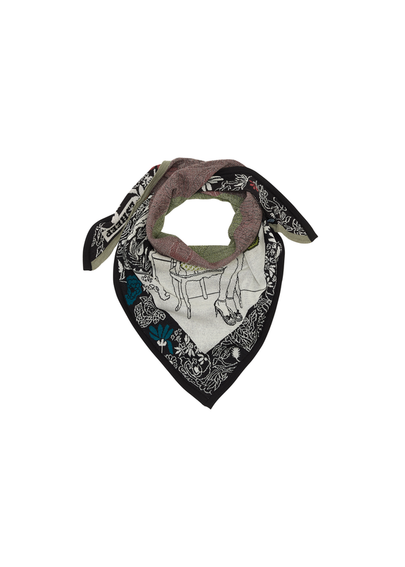 A knitted scarf tied as a bandana. Mainly white with a floral border in black and white, with blue highlights.