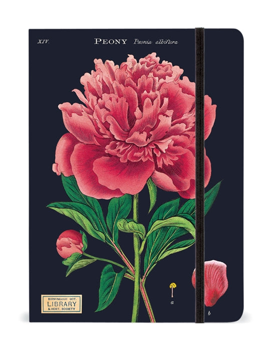 A notebook with a navy cover and an illustration of a large pink-red flower and green leaves. It is held closed by a black elastic strap.