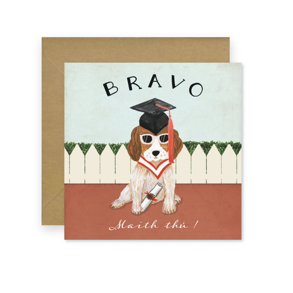 A card with a drawing of a dog wearing a graduation cap, sunglasses, and holding a rolled up certificate. Written above is 'Bravo' in capital letters and below is 'Maith thú!' in cursive.