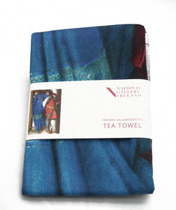 A folded tea towel with a grey label around the centre. The label shows a man in mail and a woman in blue stand on a castle staircase. The woman has her back to the viewer and her face turned from the man as they walk in opposite directions. He is embracing her arm as he descends.