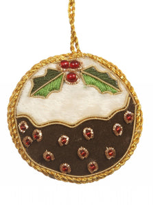 A flat felt pudding with white icing and holly on top. The berries are red beads outlined in gold thread. The whole decoration of outlined in and hanging from the same gold thread.