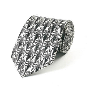 A partially rolled up tie covered in a black and white pattern of overlapping arches.
