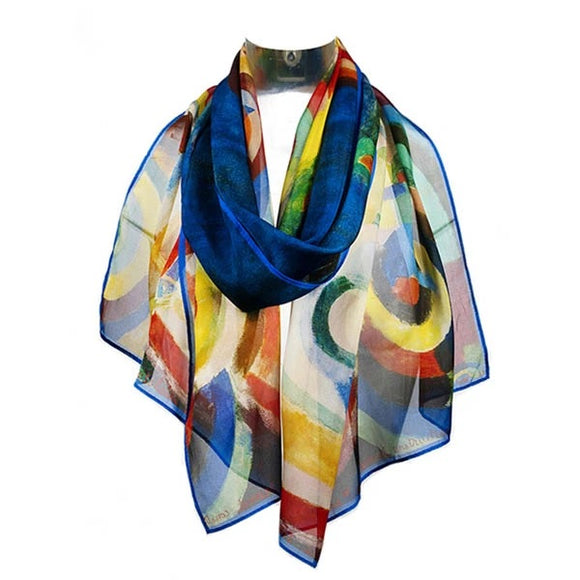 A patterned scarf primarily in blue, yellow and red, draped around an invisible neck.