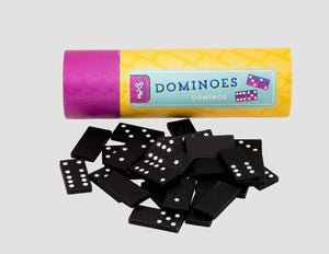 A yellow tube with a pink lid lies horizontally. 'Dominoes' is written length ways in blue. Classic black and white dominoes are scattered in front of the tube.